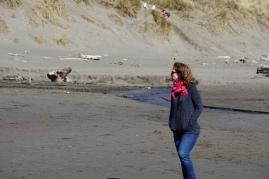 Briana enjoying watching the girls on the beach.
