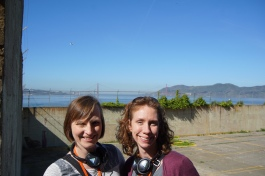 Briana and Jill outside in the yard with the Golden Gate Bridge in the background.