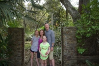 The family in front of a lovely gate.